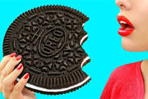 cartoon image of woman about to eat a large oreo cookie